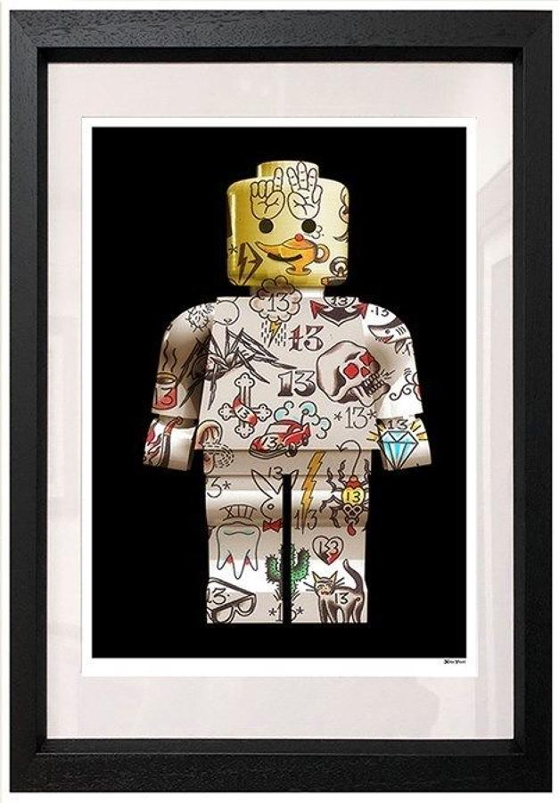 Lego Man Framed Art Print by Monica Vincent