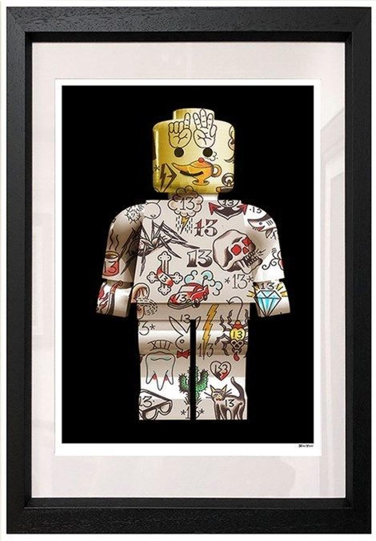 Lego Man Framed Art Print by Monica Vincent
